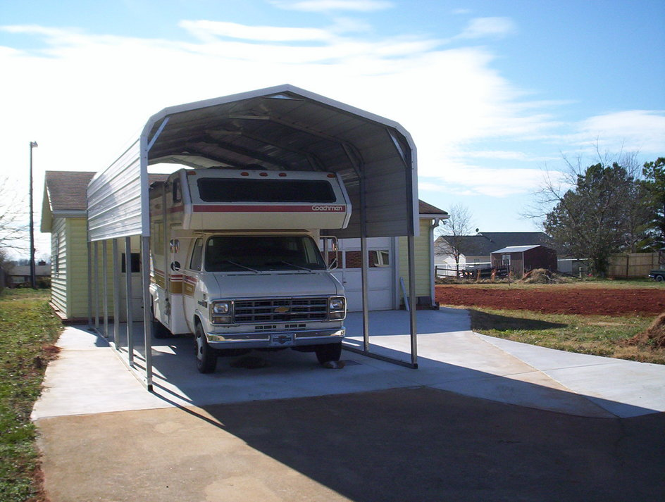 Rv covers motor home shelters rv shelters for Rv buildings